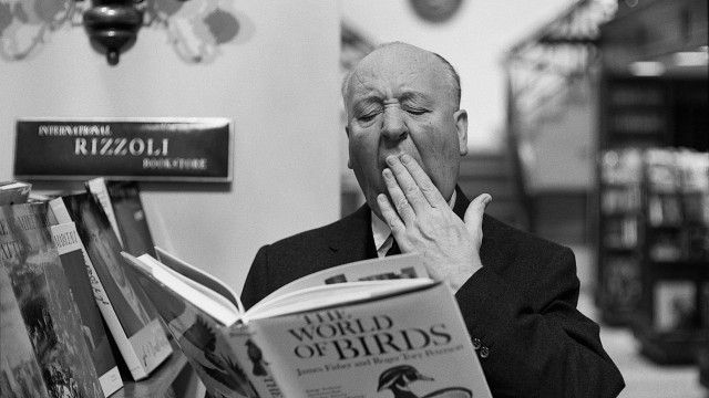 alfred-hitchcock-yawning-over-book-of-birds-at-the-rizzoli-bookstore-on-new-yorks-fifth-avenue-ny-1965
